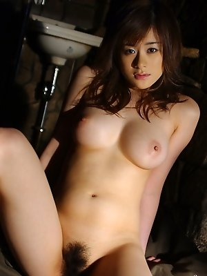 Hot Japanese model shows off her tits and hot hairy pussy in lingerie